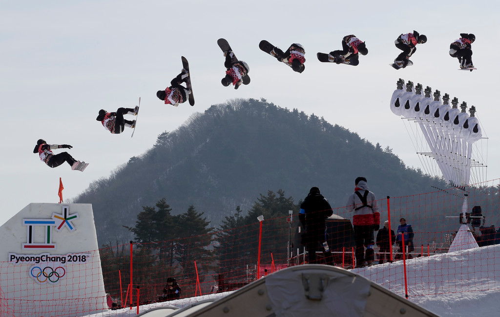 . In this multiple exposure image Laurie Blouin, of Canada, jumps during qualification for the women\'s big air snowboard competition at the 2018 Winter Olympics in Pyeongchang, South Korea, Monday, Feb. 19, 2018. (AP Photo/Dmitri Lovetsky)
