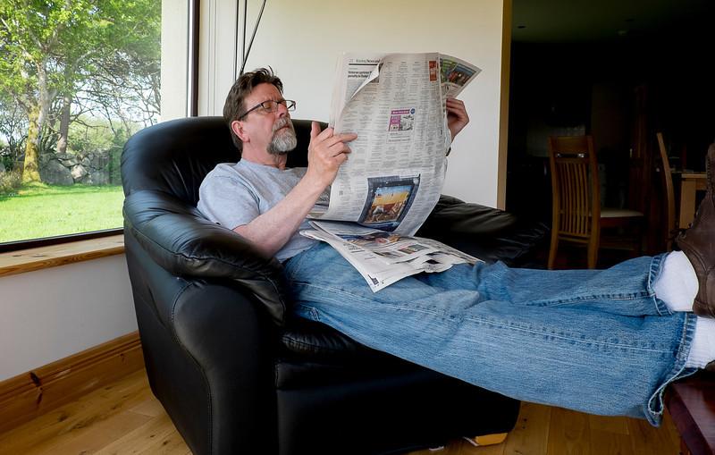 Reading The Irish Times.