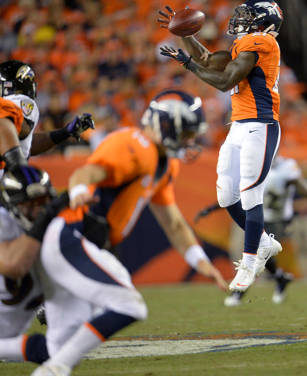 . Denver Broncos running back Ronnie Hillman (21) makes a first down catch in the third quarter, why Denver Broncos quarterback Peyton Manning (18) gets taken down in the foreground.  (Photo by Joe Amon/The Denver Post)