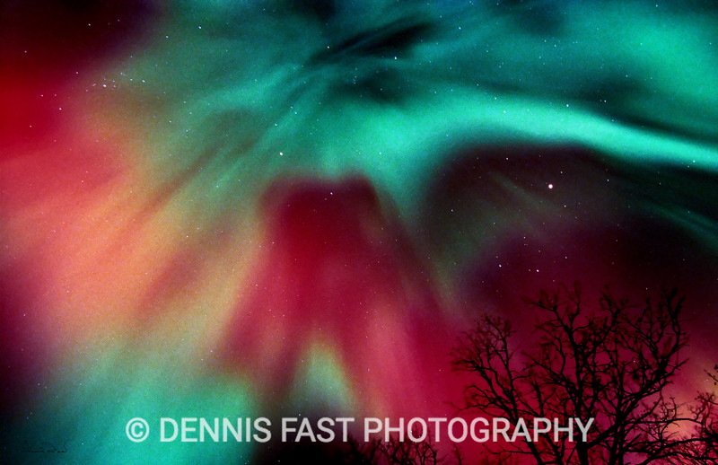 """NORTHERN LIGHTS CORONA.  Only twice in my life have I seen aurora as blood-red as this. If you ever see it, you will never forget it! Although we think of aurora as happening in the far North, this """"cloud"""" of red actually appeared well to the Southeast of Southern Manitoba where I live."""