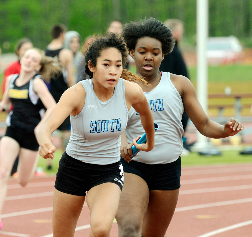 . Maribeth Joeright/MJoeright@News-Herald.com<p> South\'s Amira Churn hands the baton to teammate and anchor Mischa Sellers in the girls 4X100 meter relay during the PAC meet.