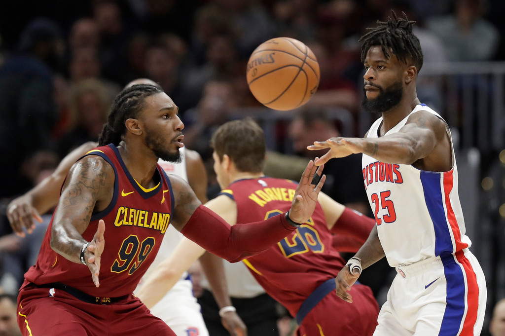 . Detroit Pistons\' Reggie Bullock (25) passes against Cleveland Cavaliers\' Jae Crowder (99) in the first half of an NBA basketball game, Sunday, Jan. 28, 2018, in Cleveland. (AP Photo/Tony Dejak)