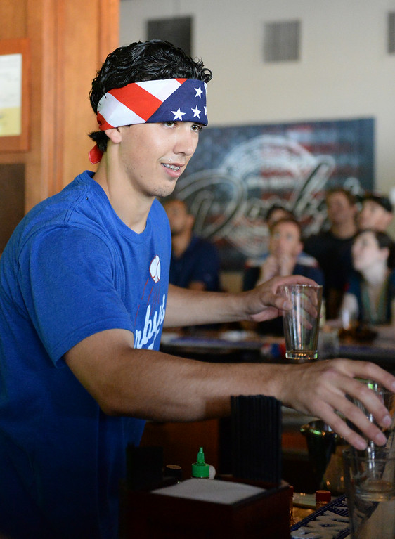. A bartender serves drinks during the USA vs Belgium world cup game viewing party on Tuesday, July 1, 2014 at Darby\'s American Cantina in Redlands, Ca. (Photo by Micah Escamilla/The Sun)
