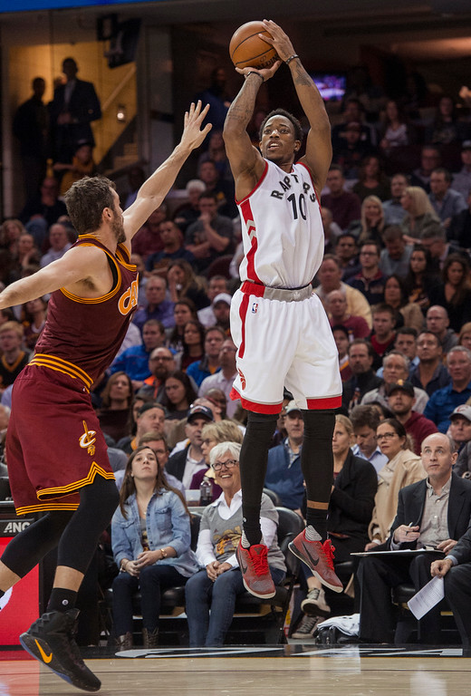 . Toronto Raptors\' DeMar DeRozan (10) shoots over Cleveland Cavaliers\' Kevin Love during the first half of an NBA basketball game in Cleveland, Tuesday, Nov. 15, 2016. (AP Photo/Phil Long)