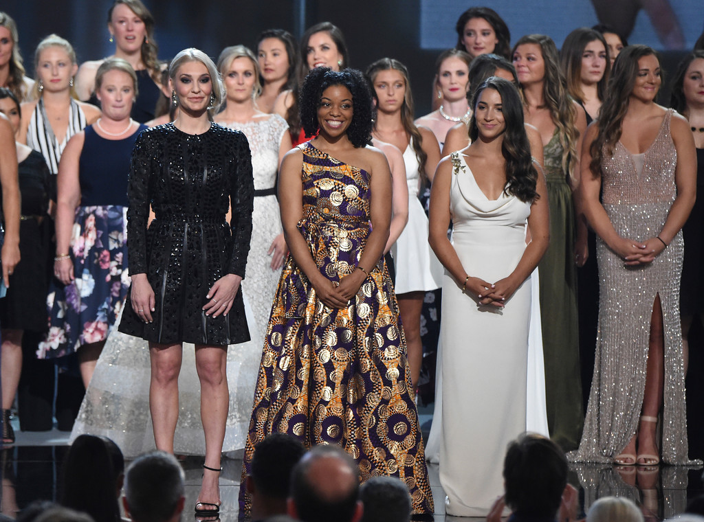 . Former gymnast Sarah Klein, former Michigan State softball player Tiffany Thomas Lopez and gymnast Aly Raisman, from left in front, and others who suffered sexual abuse accept the Arthur Ashe Award for Courage at the ESPY Awards at the Microsoft Theater on Wednesday, July 18, 2018, in Los Angeles. (Photo by Phil McCarten/Invision/AP)