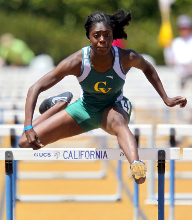 . Castro Valley\'s Sasha Wallace leads the girls 100 meter hurdles final at the North Coast Section Meet of Champions at Cal\'s Edwards Stadium in Berkeley, Calif., on Saturday, May 25, 2013. Wallace placed first. (Anda Chu/Bay Area News Group)