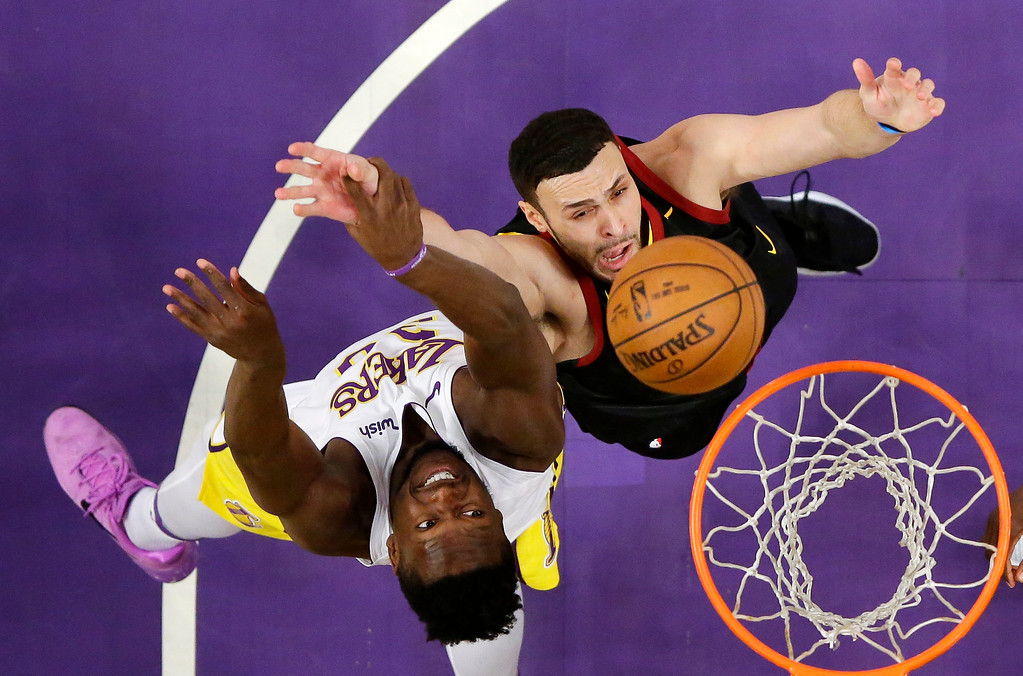 . Los Angeles Lakers forward Julius Randle, left, and Cleveland Cavaliers forward Larry Nance Jr. reach for a rebound during the first half of an NBA basketball game, Sunday, March 11, 2018, in Los Angeles. (AP Photo/Mark J. Terrill)
