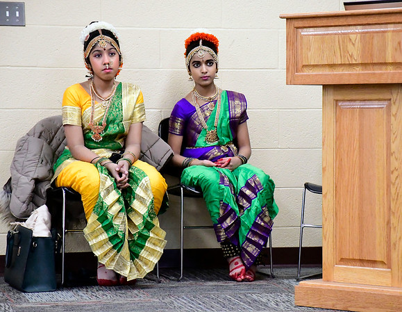 2/22/2020 Mike Orazzi | StaffrHasini Pinnamraju and Harichandana Challa look on as Sarada Nori demonstrates traditional Indian dance pieces in celebration of the festivals of Maha Shivarti and Holi while at the New Britain Public Library on Saturday afternoon.