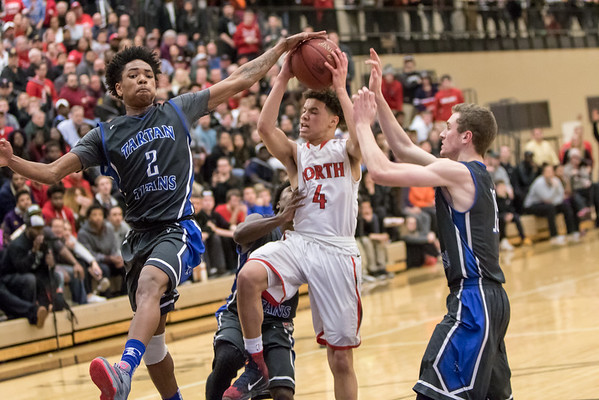 North St. Paul guard Bryce Phillips (4) has the shot blocked by Tartan forward Elijah Johnson (2) and still manages to make the basket putting North St. Paul up by two with minutes left in the Class 4A Section 4 boys basketball title game on March 3, 2016 at East Ridge High School in Woodbury, Minnesota. [ Special to Star Tribune, photo by Matt Blewett, Matte B Photography, matt@mattebphoto.com, North High School Polars, Tartan Titans, East Ridge High School, Woodbury, Minnesota, March 3, 2016.