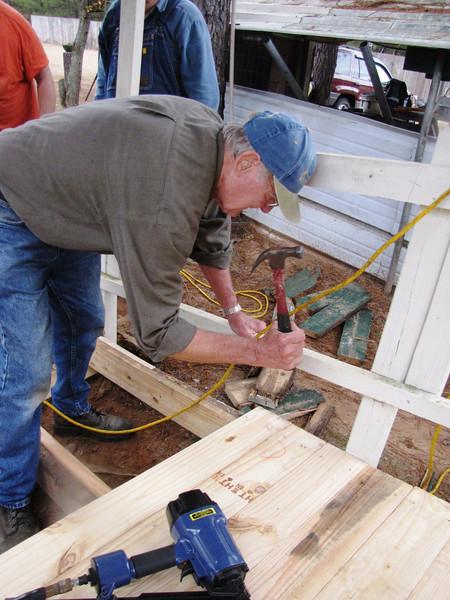 08 12-17 - Farrington swinging a hammer to repair entrance ramp. bb