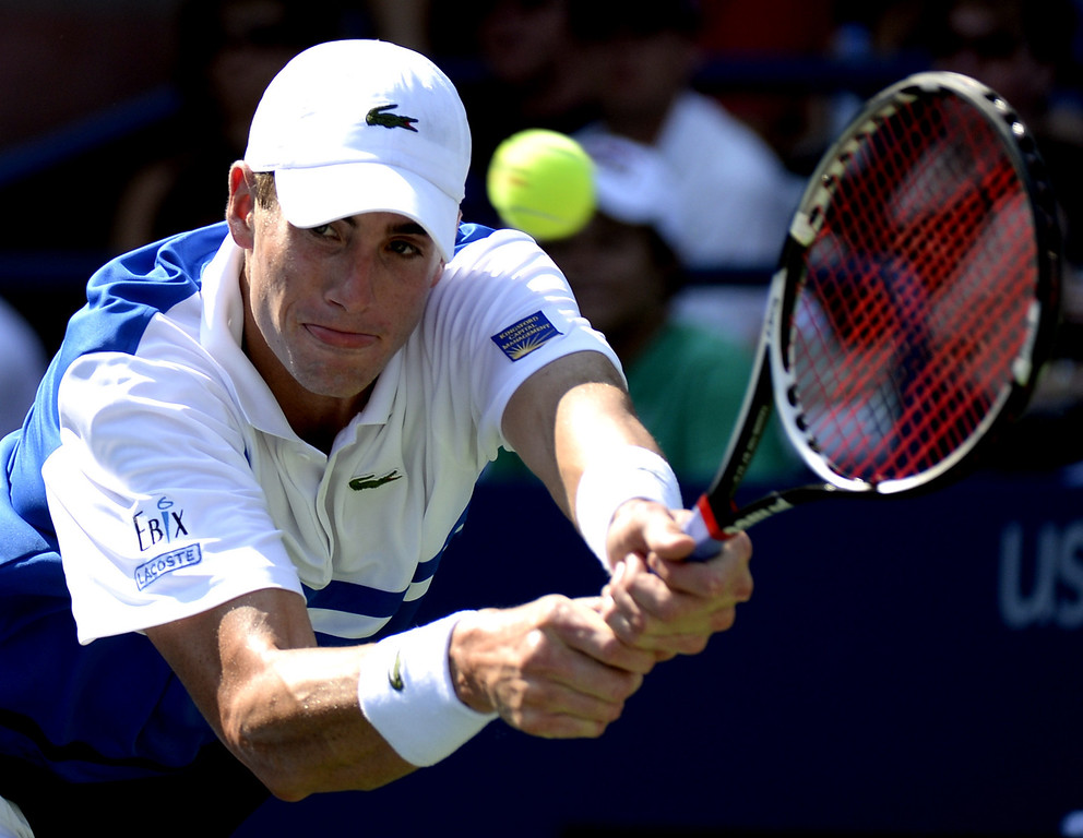. John Isner of the US hits the ball against Filippo Volandri of Italy during their 2013 US Open men\'s singles match at the USTA Billie Jean King National Tennis Center in New York on August 27 , 2013. TIMOTHY CLARY/AFP/Getty Images