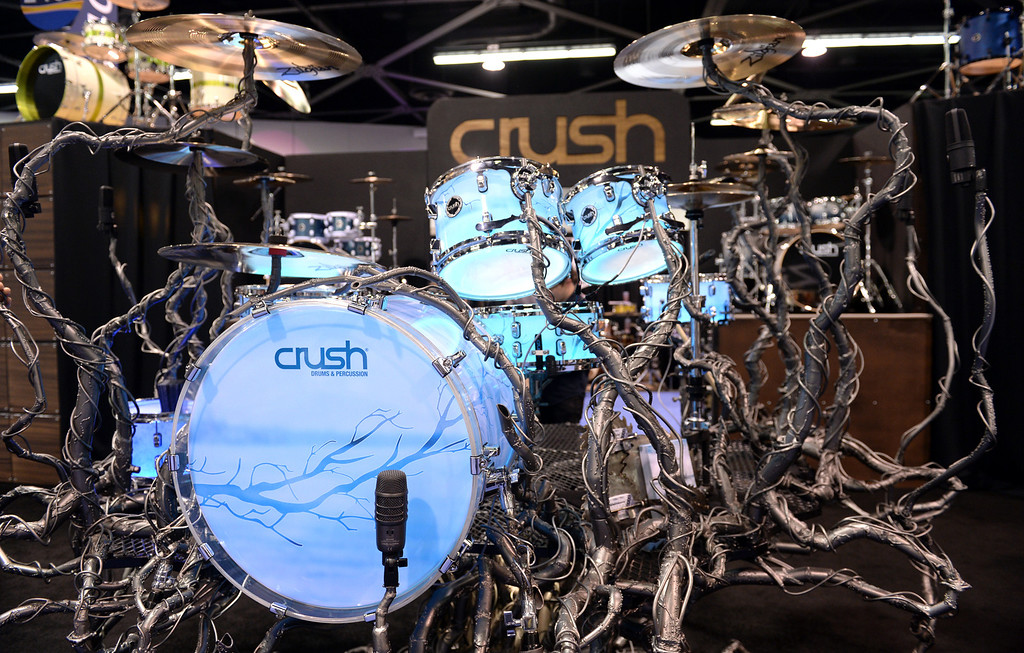 . Artist and drummer Shawn Lowery shows his Life Tree drum sculpture in the Crush drums booth during NAMM (National Association of Music Merchants), the world wide music trade show at the Anaheim Convention Center in Anaheim on Sunday January 26, 2014. NAMM is a music trade show drawing retailers and other industry people to Anaheim for four days of everything music. (Staff Photo by Keith Durflinger/San Gabriel Valley Tribune)