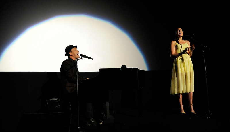 . Singers Gavin DeGraw, left, and Colbie Caillat perform together at the U.S. premiere of the film, Tuesday, Feb. 5, 2013, in the Hollywood section of Los Angeles. (Photo by Chris Pizzello/Invision/AP)