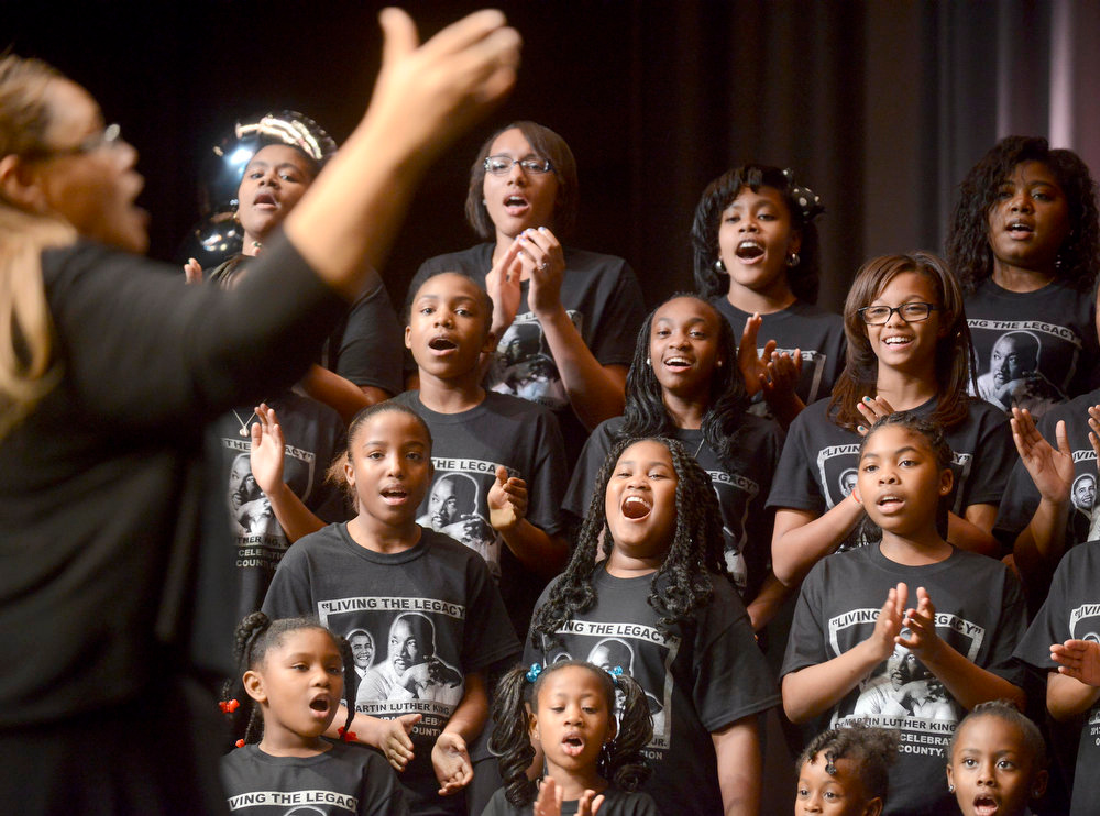 Description of . In a Sunday Jan. 20, 2012  photo, the Martin Luther King Jr. Community Youth Choir performs during an event to honor Dr. King and his legacy at the Fort Walton Beach High School auditorium, in Fort Walton Beach, Fla. Hundreds of people gathered to honor and remember the legacy of civil rights activist Dr. Martin Luther King Jr. (AP Photo/Northwest Florida Daily News, Nick Tomecek)