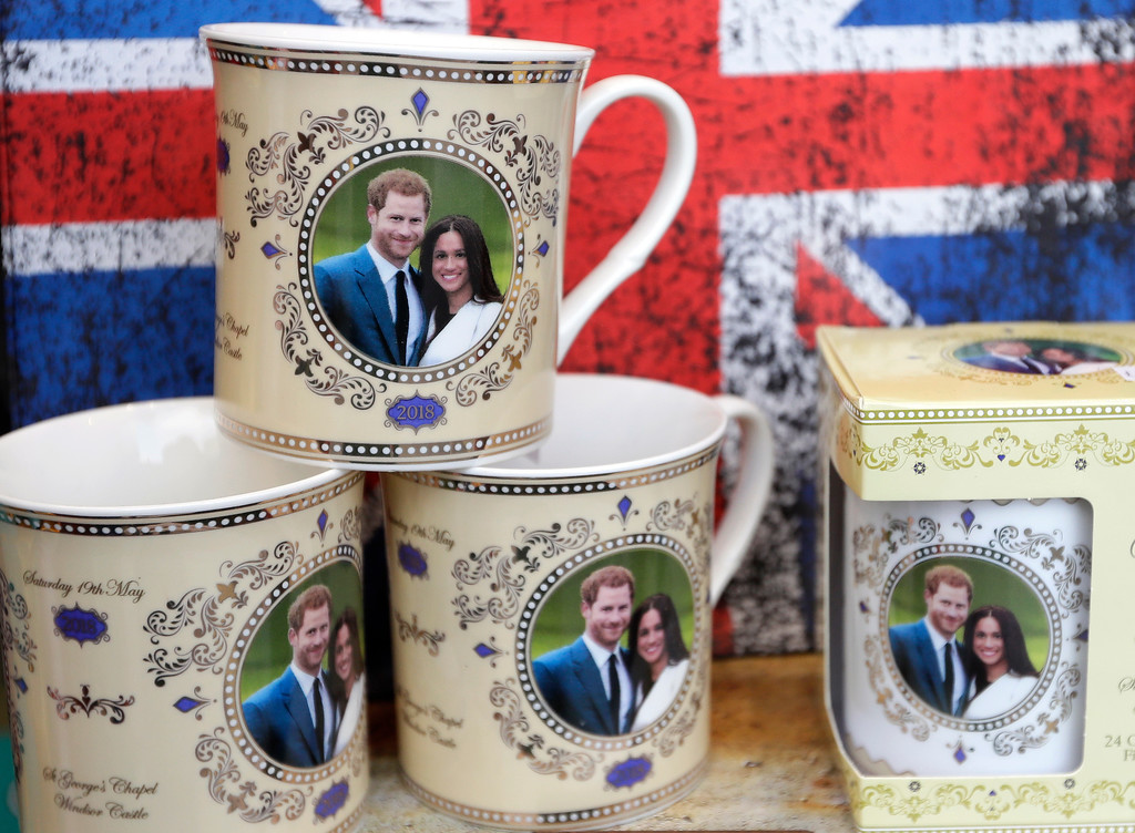 . Mugs with the image of Britain\'s Prince Harry and Meghan Markle are seen displayed for sale in a shop window in Windsor, England, Thursday, March 29, 2018. Britain\'s Prince Harry will marry Meghan Markle in Windsor on May 19. (AP Photo/Kirsty Wigglesworth)
