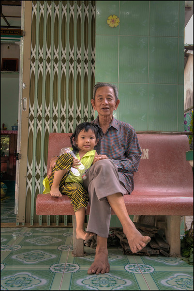Family in Phong Hoa Village in the Mekong Delta, Vietnam.