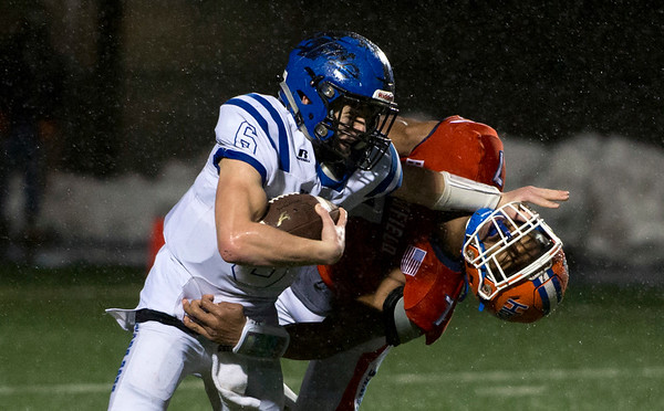 12/09/19 Wesley Bunnell | StaffrrPlainville football was defeated by Bloomfield in a CIAC playoff game on a rainy Monday night at Bloomfield High School. QB Christian Collin (6) fights off the pass rusher as he attempts to turn the right corner for a few yards.