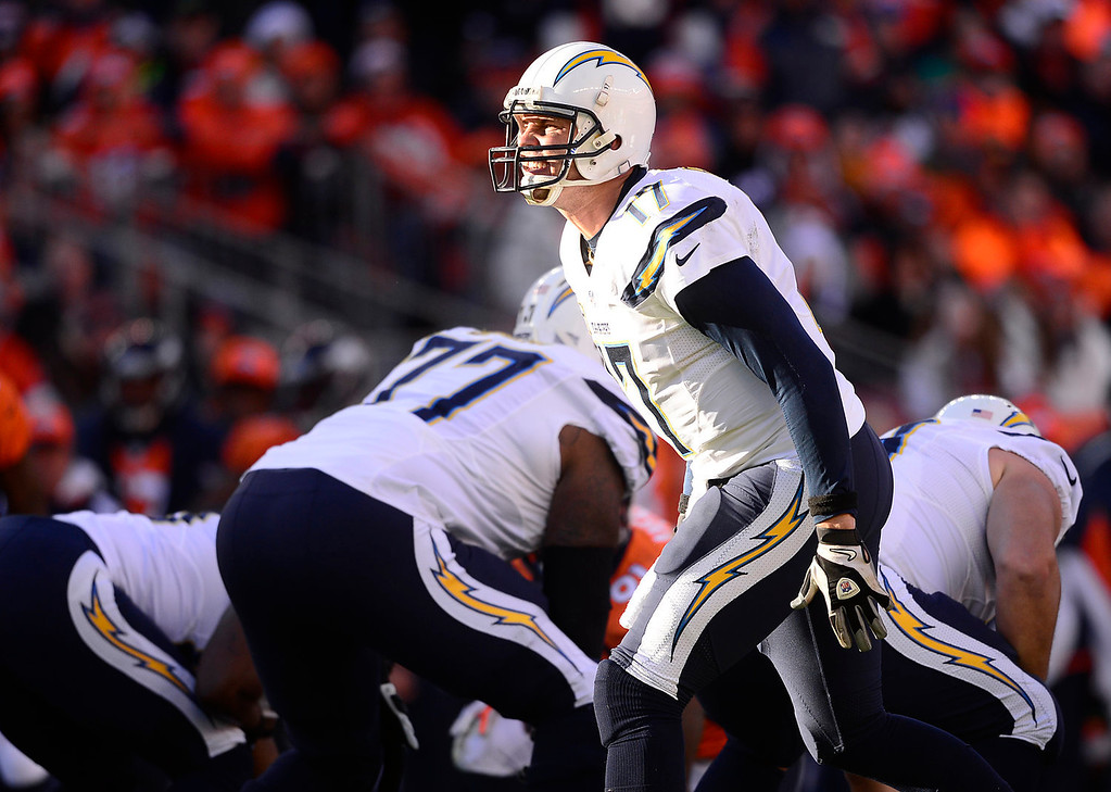 . San Diego Chargers quarterback Philip Rivers (17) yells out a play in the first quarter. The Denver Broncos take on the San Diego Chargers at Sports Authority Field at Mile High in Denver on January 12, 2014. (Photo by AAron Ontiveroz/The Denver Post)