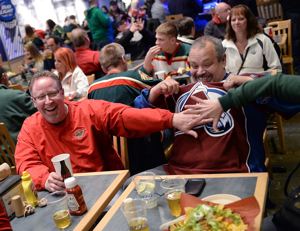 . As the only Avalanche fan in a St. Paul sports bar, Paul Verghetti took more than his share of good natured ribbing Monday night. Verghetti is from Winnipeg, Manitoba.   (Photo by Karl Gehring/The Denver Post)