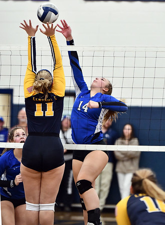 11/16/2019 Mike Orazzi | StaffrWoodstock Academy's Katherine Papp (11) and Bristol Easterns Ariana Caucci (14) during the 2019 State Girls Volleyball Tournament Class L Quarterfinals at BEHS in Bristol Saturday.