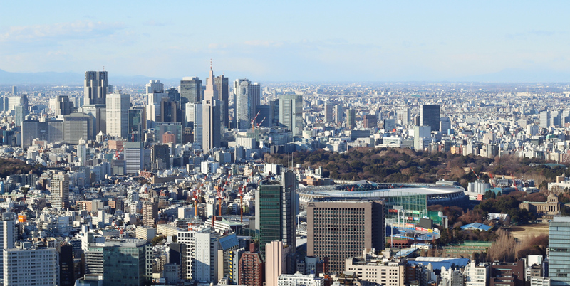 The Tokyo skyline and a view of the Olympic Stadium currently under construction. Editorial credit: Ned Snowman / Shutterstock.com