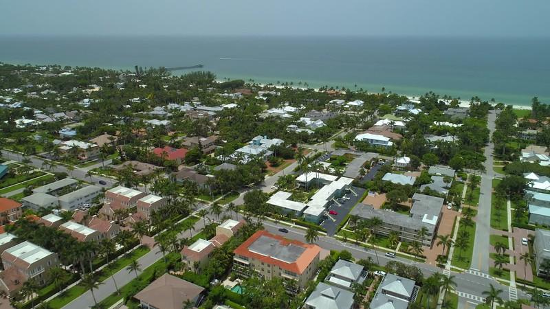 Aerial flyover homes Naples Florida residential neighborhood 4k 24p