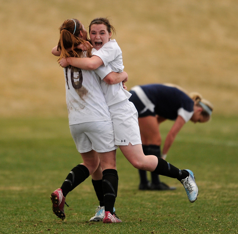 . PARKER, CO. - APRIL 2: Demons forward Katie Tubbs (19) celebrated with teammate Mariah Fluitt (10)  after Tubbs lofted a long shot past Valor goalie Kailey Norman in the second half. The Valor Christian High School girl\'s soccer team defeated Golden 4-1 Wednesday night, April 3, 2013.  Photo By Karl Gehring/The Denver Post)