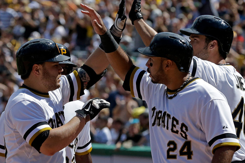 . Pittsburgh Pirates\' Russell Martin, left, is greeted by teammate Pedro Alvarez (24) after hitting a three-run home run off Colorado Rockies relief pitcher Manny Corpas (60) in fifth inning of a baseball game in Pittsburgh Sunday, Aug. 4, 2013. (AP Photo/Gene J. Puskar)