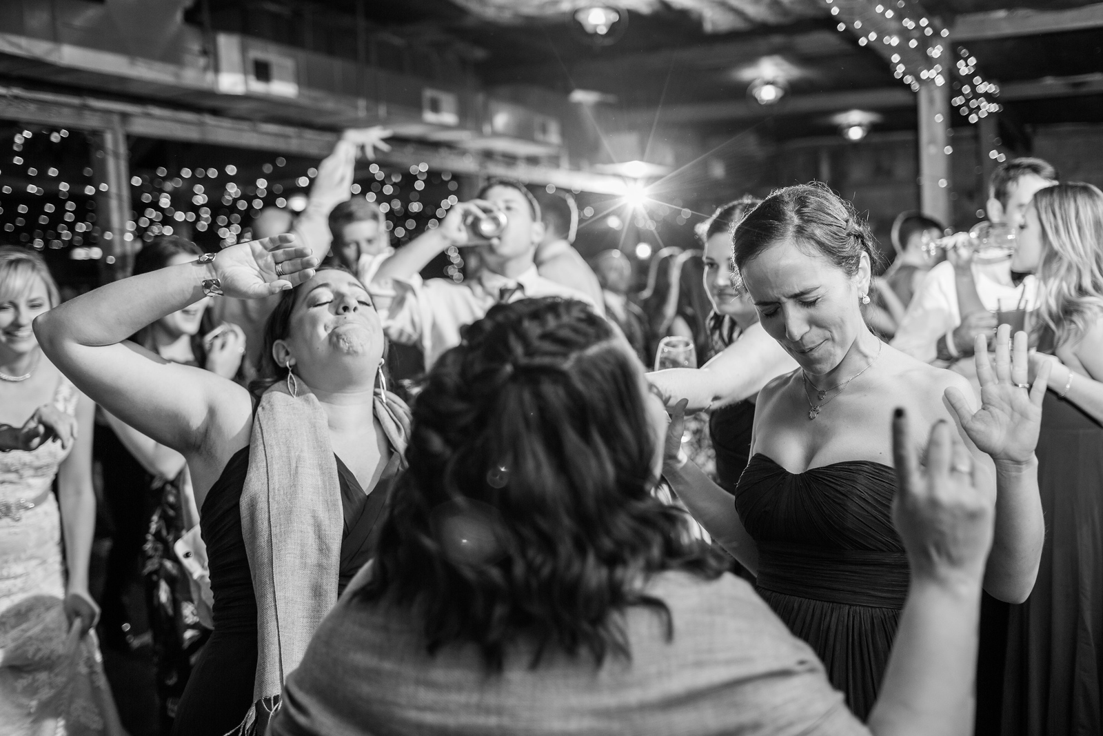 Dancing at Meg and Kyle's Bluemont Vineyards wedding. Photos by the best Washington DC wedding photographer Jalapeno Photography.