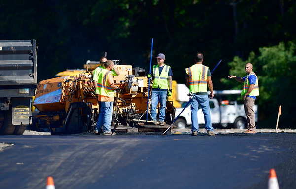 9/17/2019 Mike Orazzi | Staff Bristol city workers while paving an area of Centre Sqaure for local youth to ride their bikes in order to keep them off newly paved city streets on Tuesday.