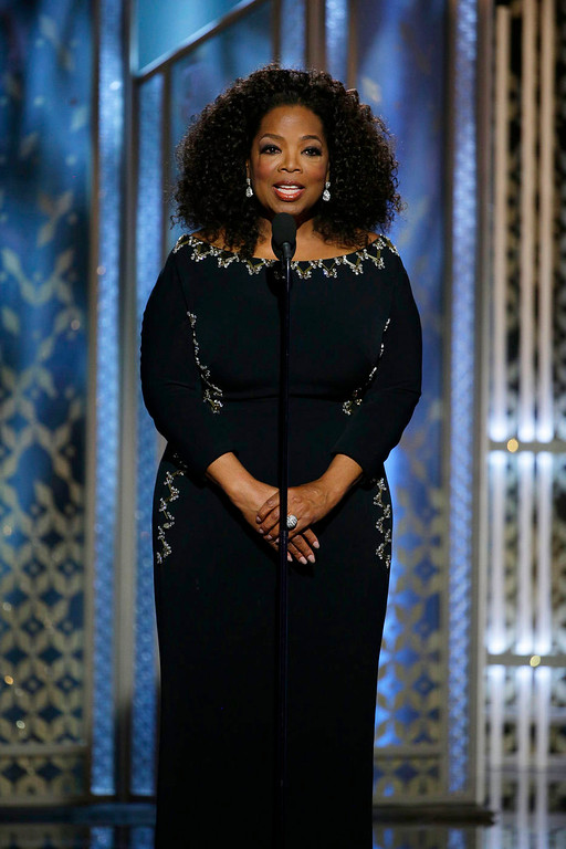 . In this image released by NBC, presenter Oprah Winfrey speaks at the 72nd Annual Golden Globe Awards on Sunday, Jan. 11, 2015, at the Beverly Hilton Hotel in Beverly Hills, Calif. (AP Photo/NBC, Paul Drinkwater)