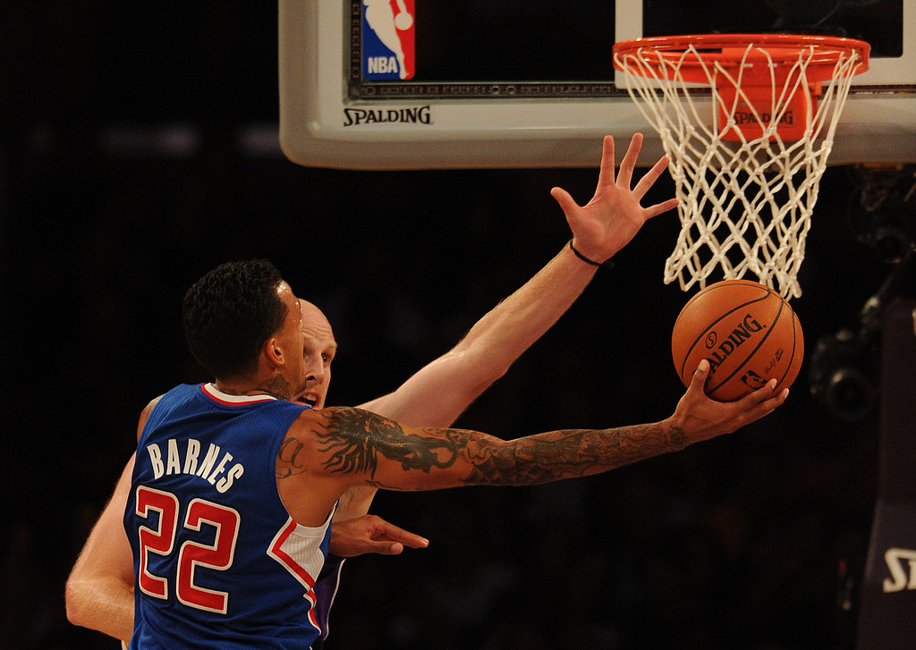 . Clippers#22 Matt Barnes is blocked buy the Lakers Chris Kaman in the 4th quarter. The Los Angeles Lakers defeated the Clippers 116 to 103 in the opening game of the season at Staples Center. Los Angeles, CA. 10/29/2013. photo by (John McCoy/Los Angeles Daily News)