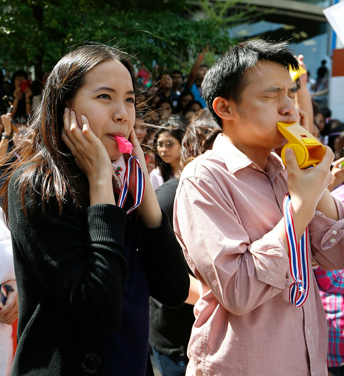 . Thai officer workers blow whistles as they join anti-government protesters rallying at the ruling Pheu Thai Party headquarters in Bangkok, Thailand, 29 November 2013. EPA/RUNGROJ YONGRIT