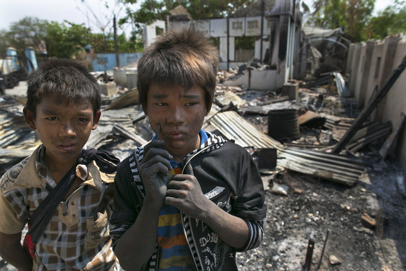 . Burmese boys stand near their destroyed home covered with charcoal on April 5, 2013 in Meiktila, Myanmar. Recent sectarian violence between Buddhists and Muslims in March left 43 people dead, with large areas of the town completely destroyed by fires and looting, while many were injured with thousands of Muslims now homeless. Many Muslims who had money fled as the violence after began to spin out of control while the remaining people are being kept in well policed IDP camps in the town.  (Photo by Paula Bronstein/Getty Images)