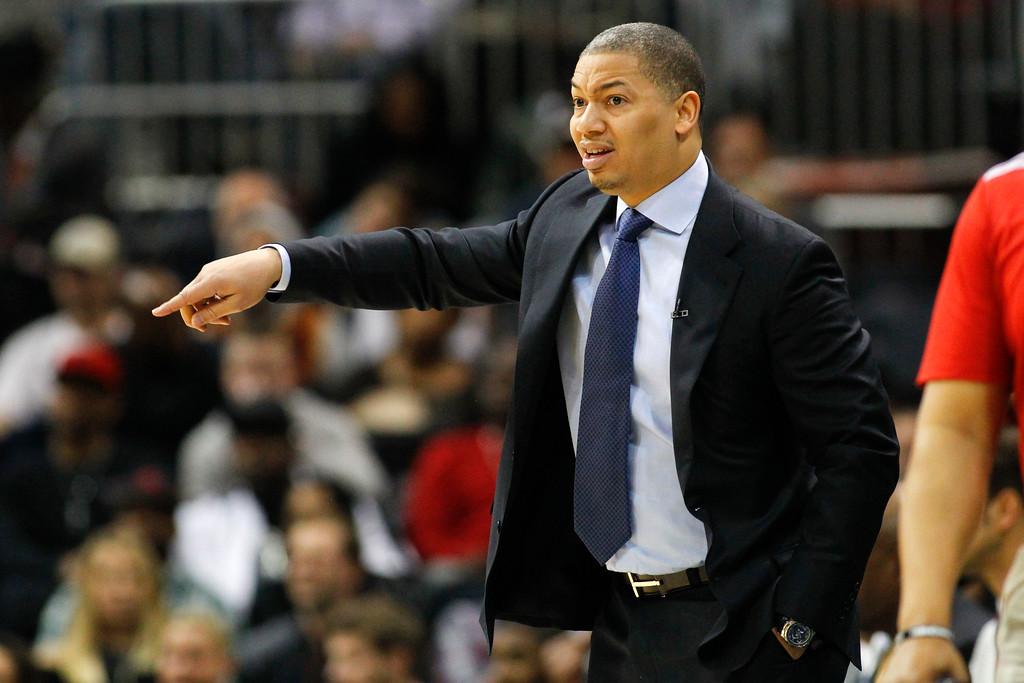. Cleveland Cavaliers head coach Tyronn Lue points against the Atlanta Hawks in the first half of an NBA basketball game, Friday, March 3, 2017, in Atlanta. (AP Photo/Brett Davis)