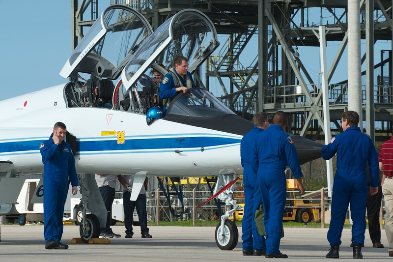 02/20/2011 -- Cape Canaveral, Florida -- Astronauts gather at a T-38 jet just after landing at the Kennedy Space Center Shuttle Landing Facility.
