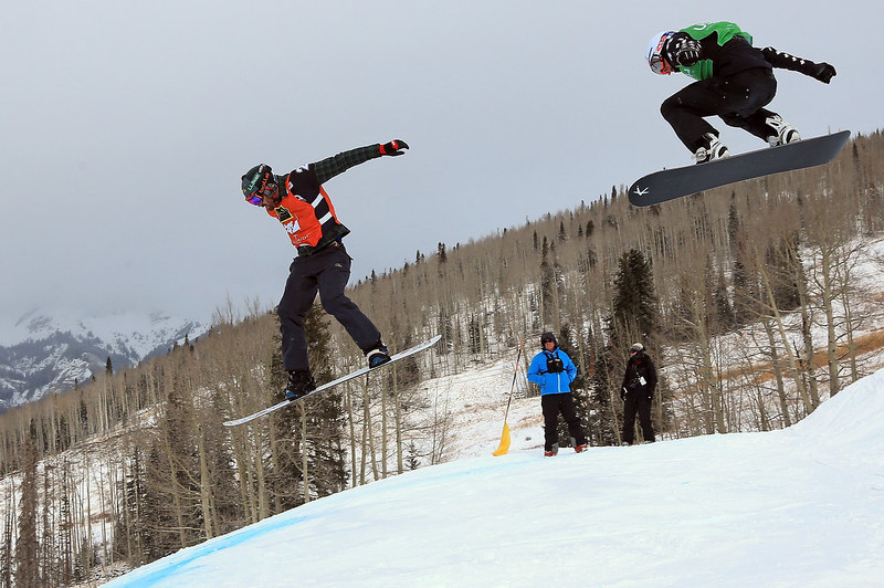 . (L-R) Seth Wescott of the USA leads Kevin Hill of Canada in the second leg of the quarter finals in the USANA Snowboardcross World Cup Team Event on December 15, 2012 in Telluride, Colorado. Wescott and teammate Nate Holland went on to finish first overall. (Photo by Doug Pensinger/Getty Images)