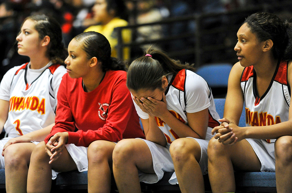 . Etiwanda reacts as they lose the final quarter to Santiago High School during the CIF-SS Div. I-AA Girls Basketball Championship game at the Anaheim Convention Center on Friday, Mar. 1, 2013. Etiwanda was defeated by Santiago 70-65. (Rachel Luna / Staff Photographer)