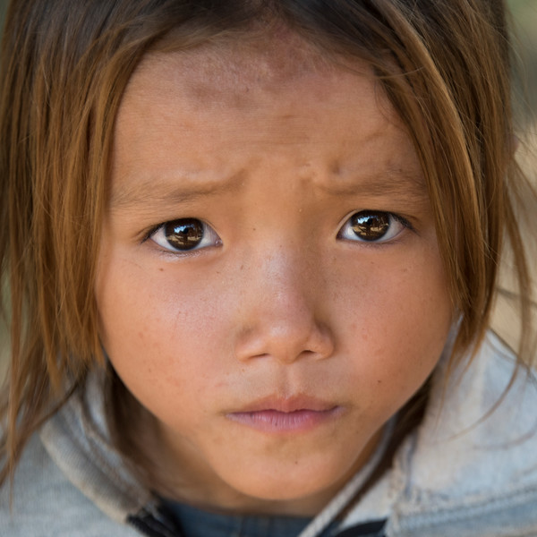 Portrait of local girl looking at the camera, Sainyabuli Province, Laos