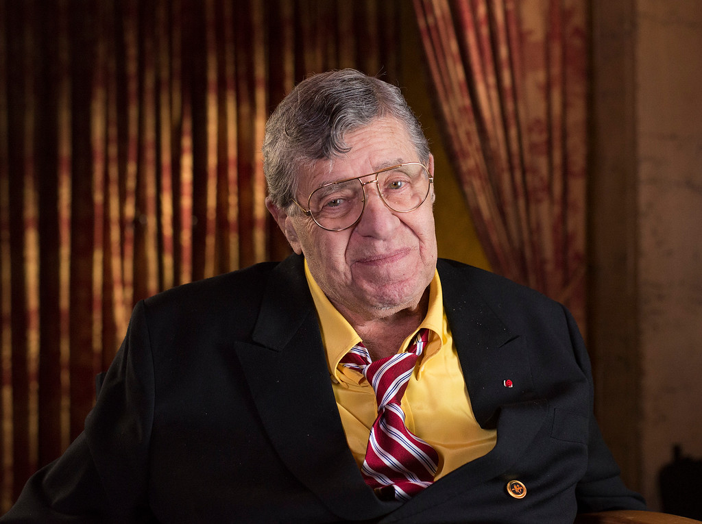 . FILE - In this April 12, 2014, file photo, actor and comedian Jerry Lewis poses during an interview at TCL Chinese Theatre in Los Angeles. Lewis, the comedian and director whose fundraising telethons became as famous as his hit movies, has died. Publicist Candi Cazau said Lewis passed away Sunday, Aug. 20, 2017, at age 91 in Las Vegas with his family by his side. (Photo by Dan Steinberg/Invision/AP Images, File)