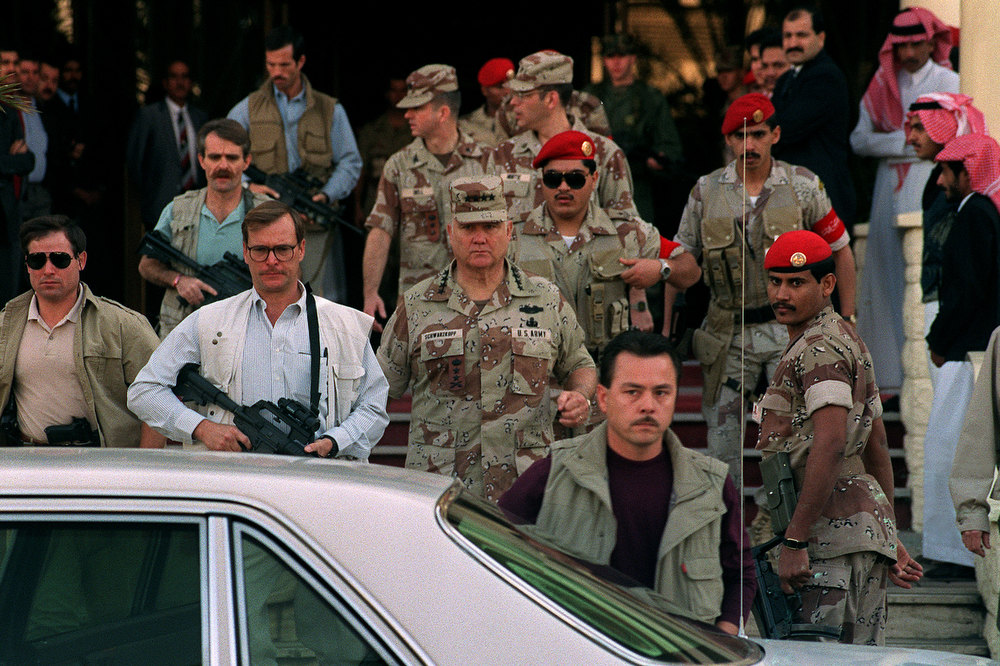 . Gulf War commander, US four star general Norman Schwarzkopf (C), who commanded the international coalition which ousted Iraqi forces from Kuwait during Operation Desert Storm, leaves 10 February 1991 in Riyadh the Hotel Hayatt under the watchful eyes of his bodyguards.  (MICHEL GANGNE/AFP/Getty Images)