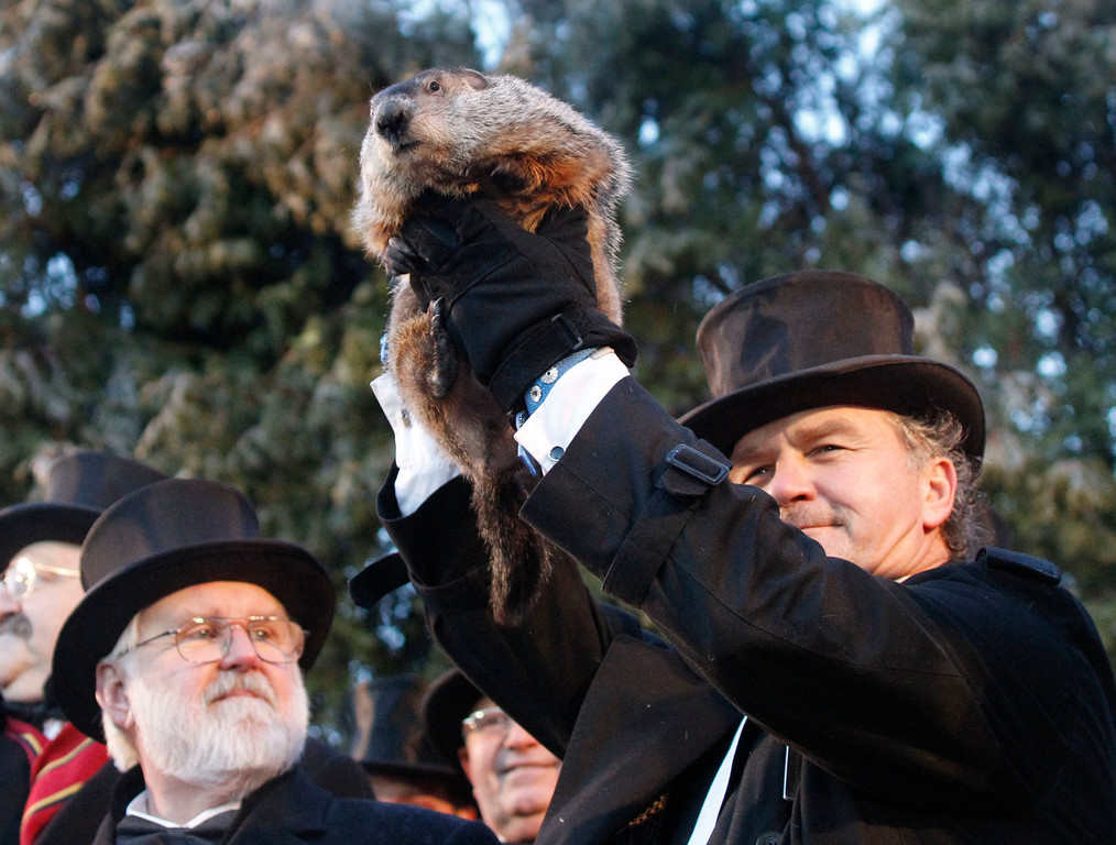 . Groundhog Club handler John Griffiths holds Punxsutawney Phil, the weather predicting groundhog, during annual Groundhog Day festivities Wednesday, Feb. 2, 2011, in Punxsutawney, Pa. The Groundhog Club claimed that Phil did not see his shadow and predicted that winter has ended on Groundhog Day. (AP Photo/Keith Srakocic)