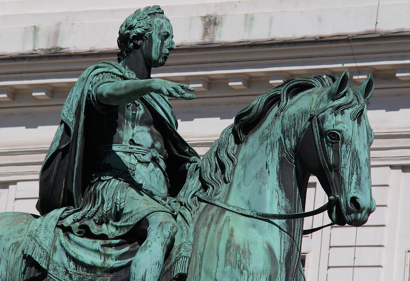 Statue of Emperor Joseph II at the Josephplatz, Vienna Austria in front of the Prunksaal.  The statue faces the performing arena and stalls containing the famous Lippenzaner Horses of the Royal Riding School, which is just across the street .