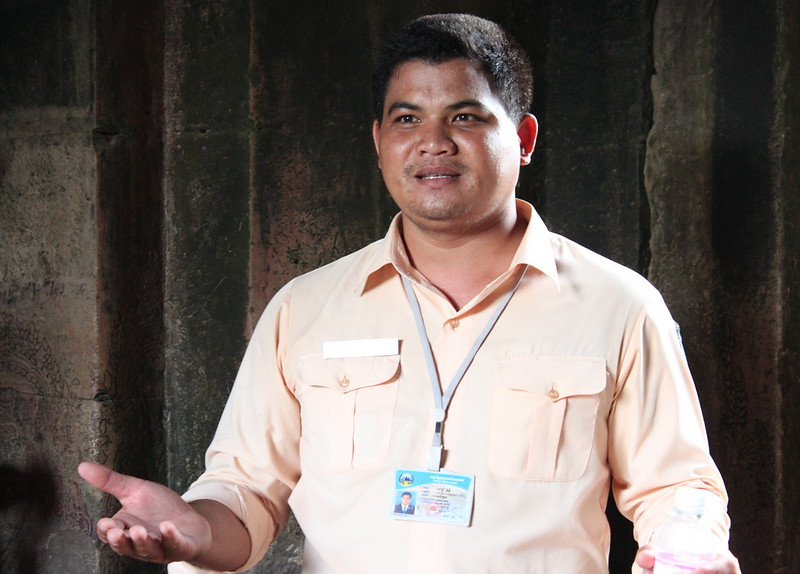 Smiling Albino host, Mr. Vuthy sharing some colorful history inside Angkor Wat