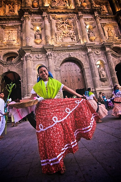 A Jarabe Mixteco traditional dancer pauses for a pose during a street festival in Oaxaca, Mexico.