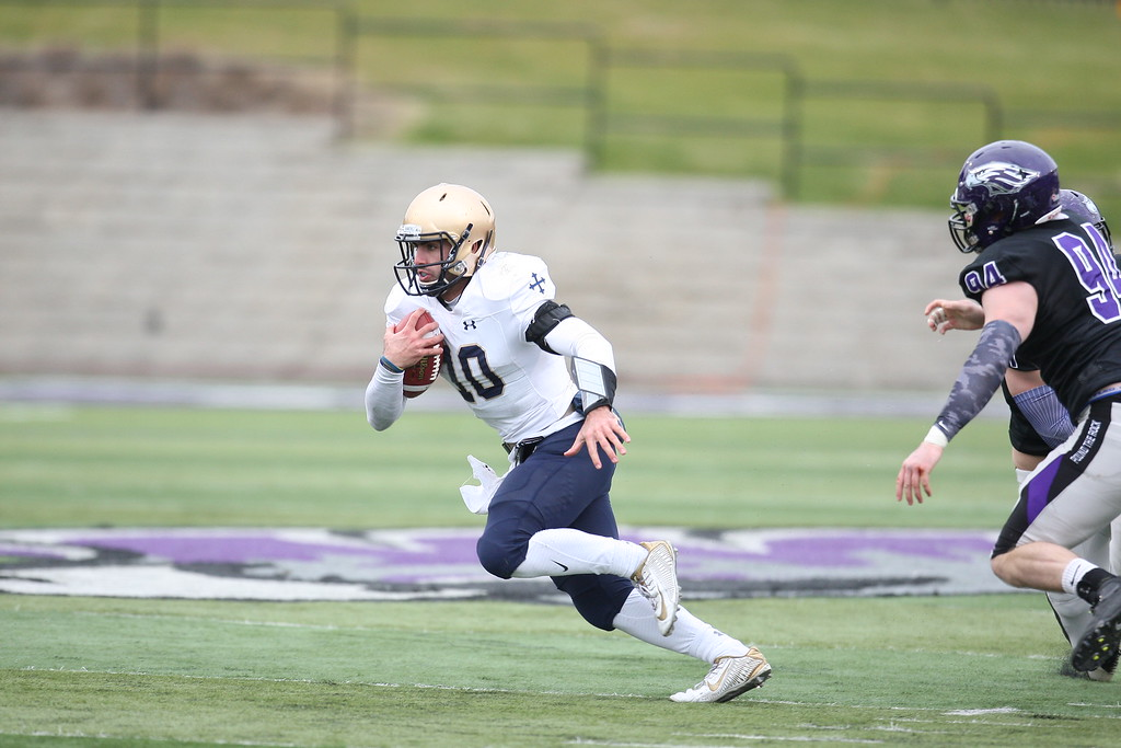 . John Reid - The News-Herald Anthony Moeglin looks upfield for yards during John Carroll\'s win over Wisconsin-Whitewater on Dec. 3.