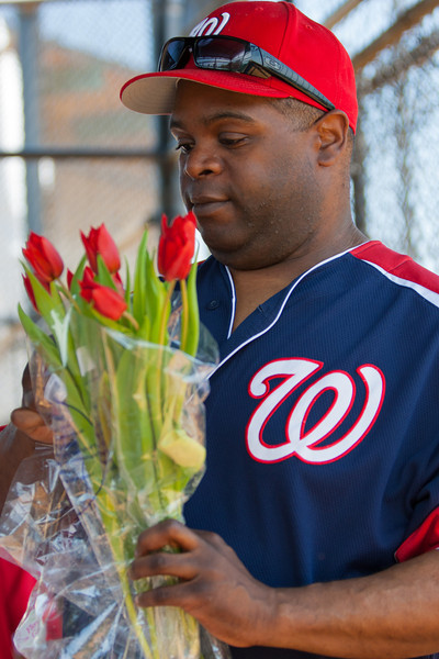 Coach Coop showing his softer side before a Mother's Day baseball game. The bats of the Nationals were supported by a great defensive outing in a 11-4 win over the Twins. They are now 7-3 for the season. 2012 Arlington Little League Baseball, Majors Division. Nationals vs Twins (13 May 2012) (Image taken by Patrick R. Kane on 13 May 2012 with Canon EOS-1D Mark III at ISO 400, f4.0, 1/400 sec and 98mm)