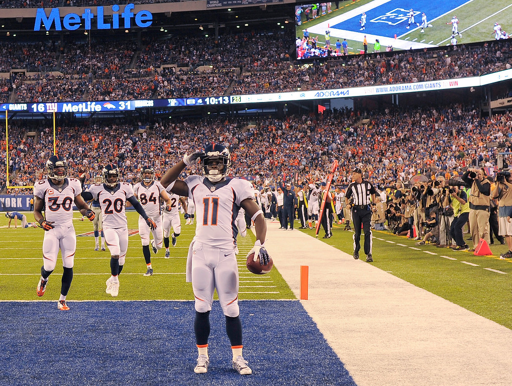 . Denver Broncos wide receiver Trindon Holliday (11) salutes the crowd after returning a punt 81 yards for a touchdown during the fourth quarter September 15, 2013 MetLife Stadium. (Photo by John Leyba/The Denver Post)