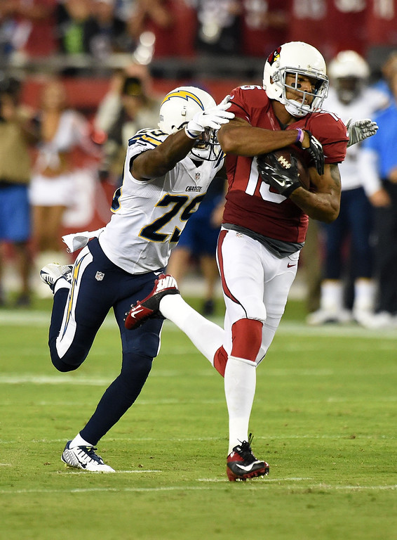 . Wide receiver Michael Floyd #15 of the Arizona Cardinals makes a 63-yard reception against cornerback Shareece Wright #29 of the San Diego Chargers during the first quarter University of Phoenix Stadium on September 8, 2014 in Glendale, Arizona.  (Photo by Norm Hall/Getty Images)