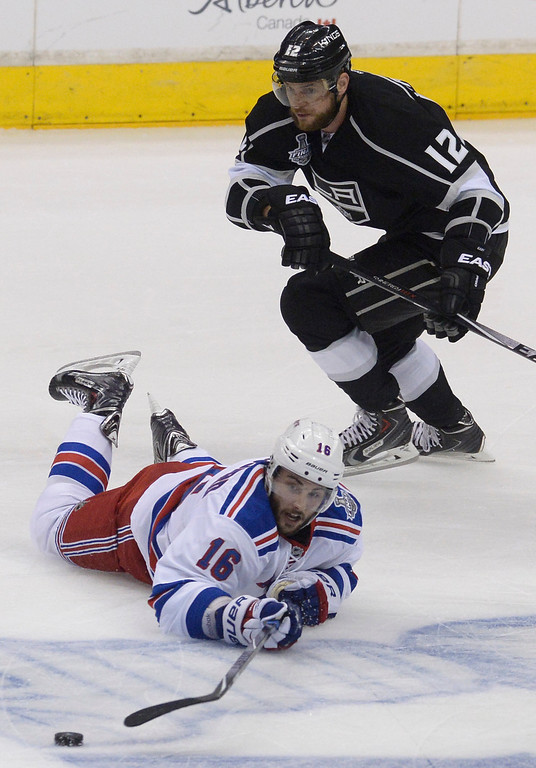 . Rangers#16 Derick Brassard falls to the ice to keep the puck away from Kings#12 Marian Gaborik in the first period. The Los Angeles Kings faced the New York Rangers in game 2 of the Stanley Cup Final.  Los Angeles, CA. 6/7/2014(Photo by John McCoy Daily News)